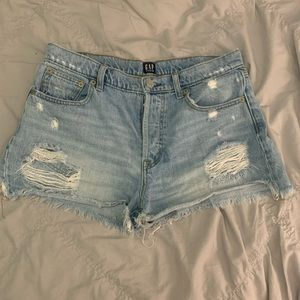 Faded wash denim ripped jean shorts. Size 27.